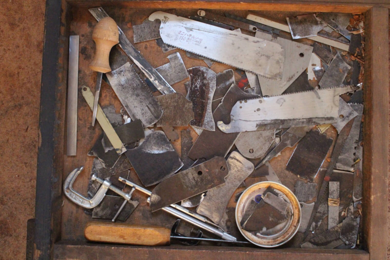 Drawer of assorted scrapers for cabinet and chairmaking