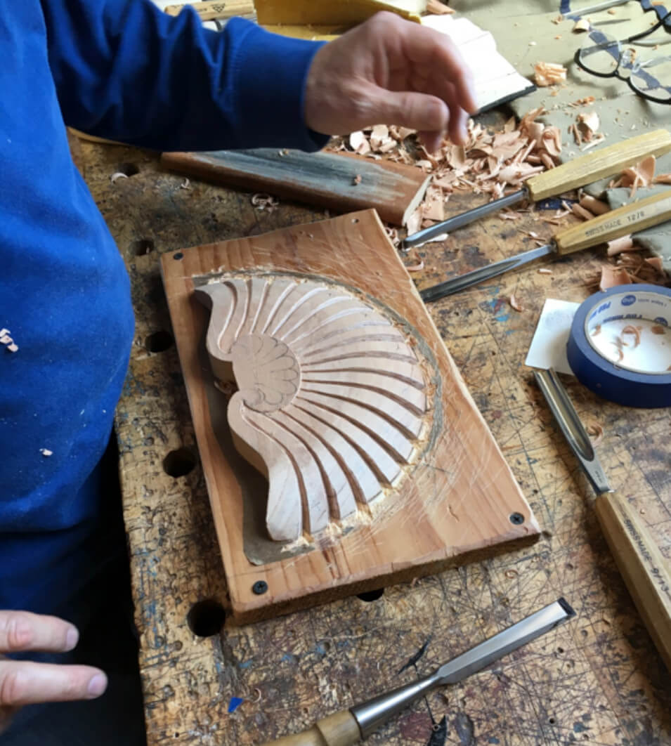 Student carving a shell at Allan Breed School of Woodworking
